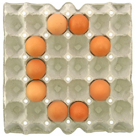 letter c: A letter C from the eggs in paper tray for food or nutrition concept