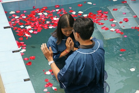baptize: Chiangmai, Thailand - August 8, 2015 : Ceremony of baptism. Christian make baptism in water pond at Chiangmai Fellowship Church in Chaingmai, Thailand. Editorial