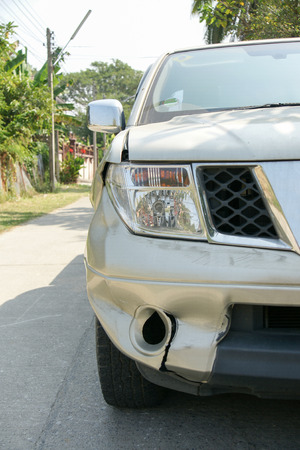 dent: A dent on the right front of a pickup truck damage from crashed accident Stock Photo
