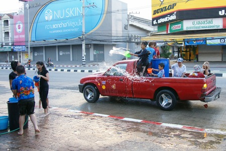 everybody: CHIANGMAI, THAILAND - APRIL 15, 2012 : People in a Songkran water fight festival. Songkran is a joyful summer festival which everybody can splash water to them for cool down from hot weather.