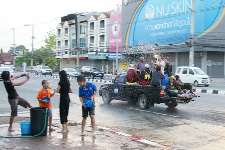 chiangmai: CHIANGMAI, THAILAND - APRIL 15, 2012 : People in a Songkran water fight festival. Songkran is a joyful summer festival which everybody can splash water to them for cool down from hot weather.