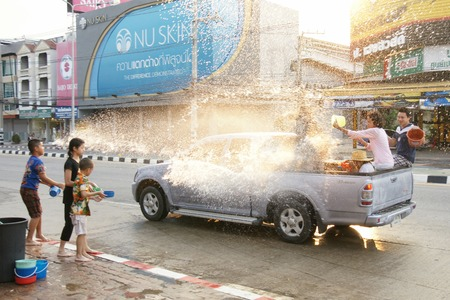 chiangmai: CHIANGMAI, THAILAND - APRIL 14, 2012 : People in a Songkran water fight festival. Songkran is a joyful summer festival which everybody can splash water to them for cool down from hot weather.