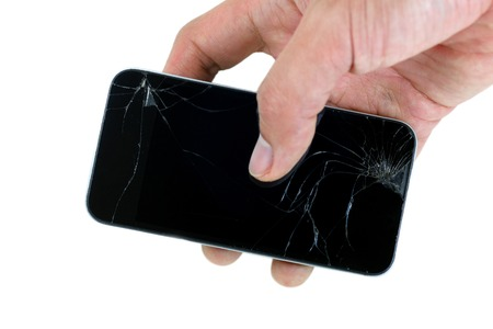 portable failure: Right male hand holding a cracked smartphone isolated on white background