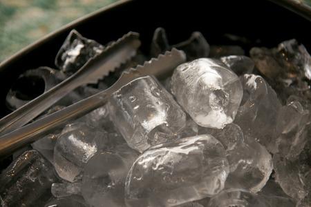 steel bucket: Black plastic ice bucket and stainless steel ice tongs
