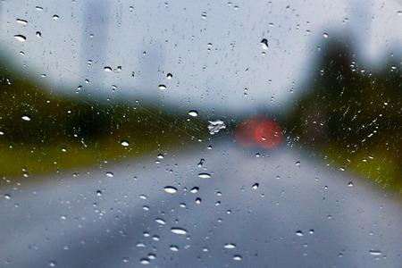 Rain drop on the car glass background 스톡 콘텐츠