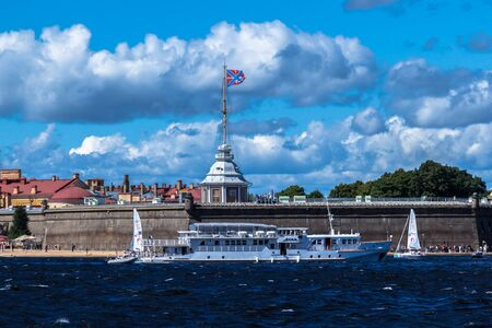 SAINT-PETERSBURG, RUSSIA - AUGUST 29, 2018: pleasure boat on the background of Peter and Paul fortress