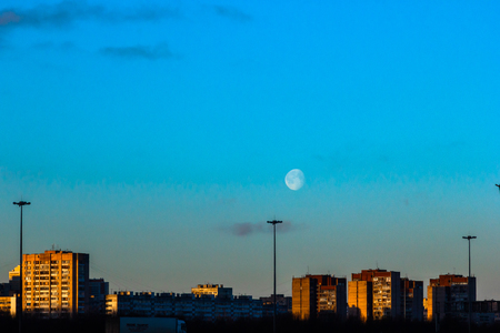 old buildings of the city under the moonlight during the day