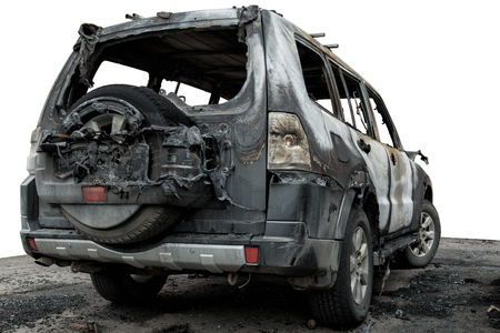 partially burned down car for use in photomontage, the SUV after the fire, isolate.