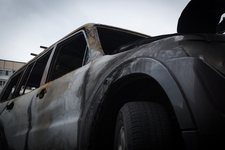 partially burned down car after the fire, parts of body the burned handles of doors and the burst glasses, picture not from pleasant, the insured cars after the fire
