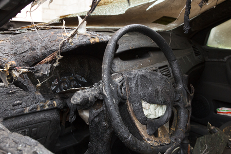 partially burned down parts of the car, the children's chair, meter panel, airbag, chair upholstery, the radio tape recorder, charred the panel and which has burst from temperature car glass
