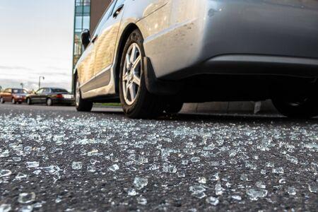 Broken rear glass of car spread fragments of glass on asphalt 写真素材
