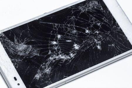 broken phone with cracked screen