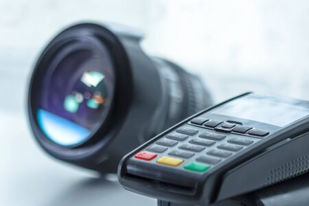 photographic equipment credit payment, terminal on white background