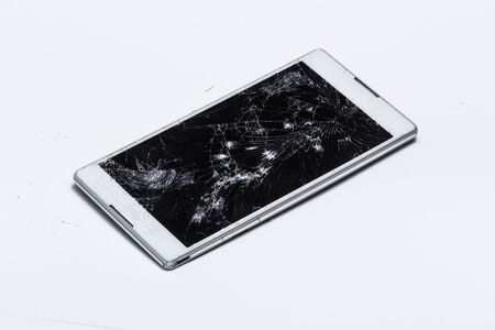 cracked screen on mobile device, white modern phone