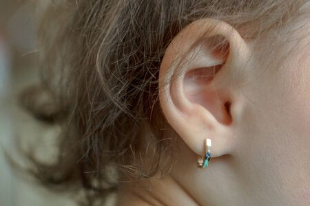 the puncture of ears to children is younger than three years Фото со стока