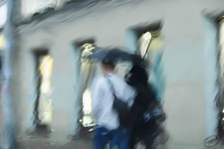 It 's raining hard, through the window. Blurred silhouettes of people in the city go about their business Stock fotó