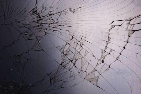 Top view cracked broken mobile screen glass texture background.