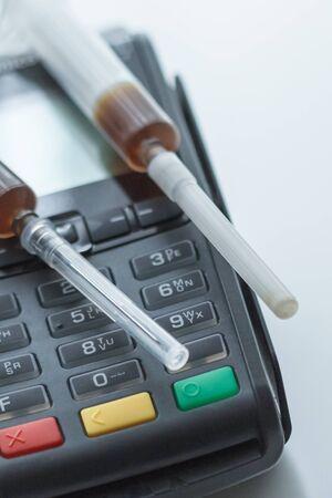 Legal drug trade via credit terminal 写真素材