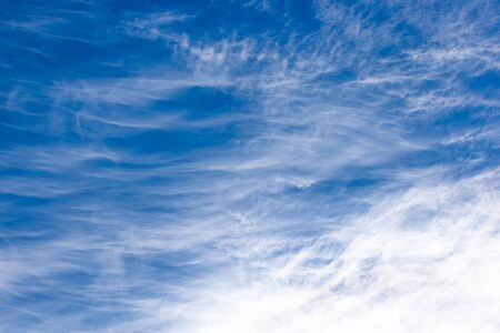 plumose clouds of the top tier in blue space of the sky.