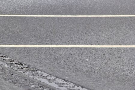 slush dampness on the road sleet even layer.