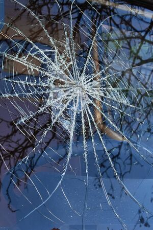 a broken car windshield like a spider's web.