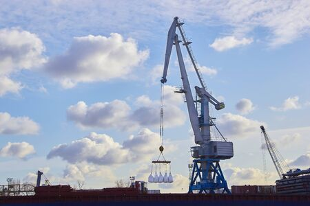 cargo crane for loading raw materials on sea vessels.