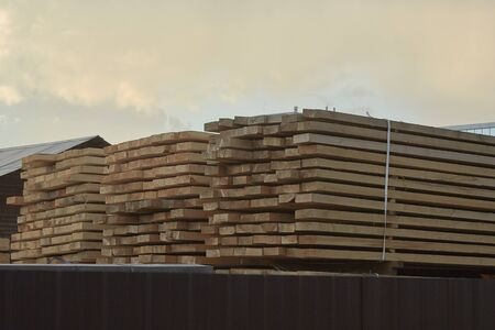 Pallet storage of wood in the company in the industrial zone of the city on a spring day.