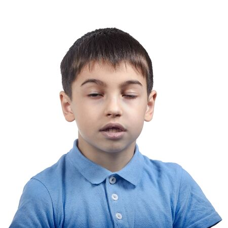 yawns bored boy in blue t shirt isolate Stock fotó