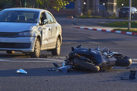 a bike crashed into a car a motorcyclist was injured police investigation fingerprint investigator.