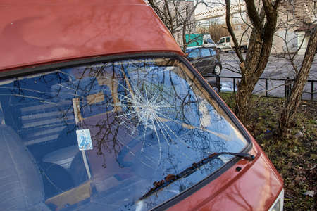 Russia, Saint-Petersburg, September 2019: Broken Glass Window on a red car