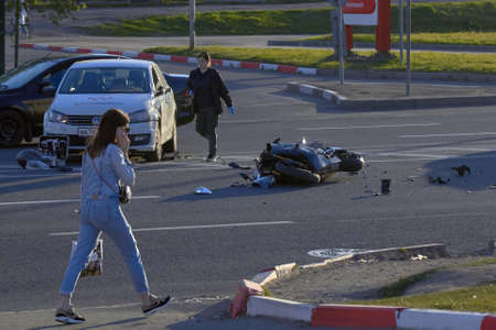 Saint Petersburg, Russia-May, 2020: a bike crashed into a car a motorcyclist was injured police investigation fingerprint investigator.
