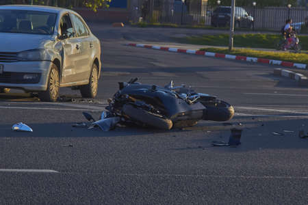 a bike crashed into a car a motorcyclist was injured police investigation fingerprint investigator. Stock Photo