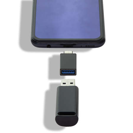 Phone or smartphone with USB OTG data transfer connected to a USB flash drive, read and write any information from portable information sources 免版税图像