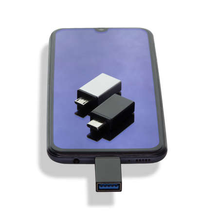 Isolated on a white background phone or smartphone with USB OTG data transfer connected to USB flash drive