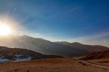 Beautiful sunset in the mountains evening view of the Tien Shan mountain range, Kyrgyzstan, view from the mountain slope of the ski base