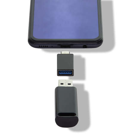 Phone Isolated on a white background data transfer via a universal USB flash drive adapter.
