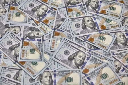 100 USD banknotes lots of background texture close up money