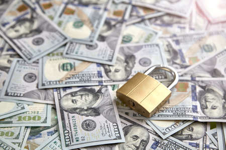 Financial security. padlock on the background of money. The concept of storing and protecting saving money Standard-Bild
