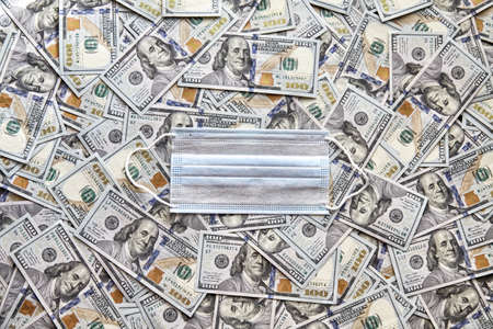 medical mask on the background of dollars