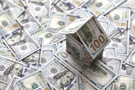 house of money on the background of money, dollar bills the concept of accumulating investing money