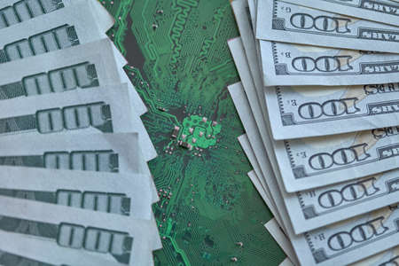 Printed circuit board chips, electronics technology, against the background of money. The concept of technological progress Standard-Bild