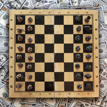 chessboard against the background of money, business development strategy concept