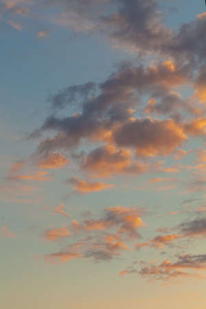 Low-flying cumulus clouds at sunset Standard-Bild