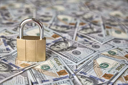 Financial security. padlock on the background of money The concept of storing and protecting saving money Standard-Bild