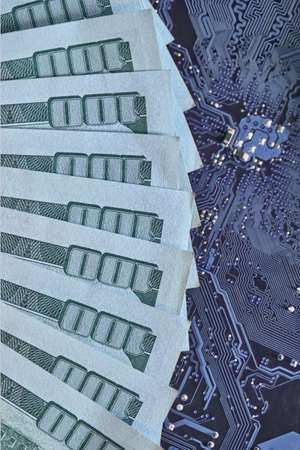 Circuit board chips, electronics, against the background of money. The concept of technological progress