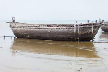 Ancient ruins of a large boat at sea photo