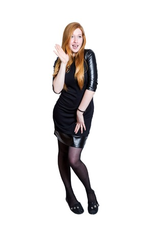Red haired businness girl in black dress isolated on white background