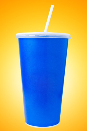 disposable cup: Blue disposable cup close up on yellow background