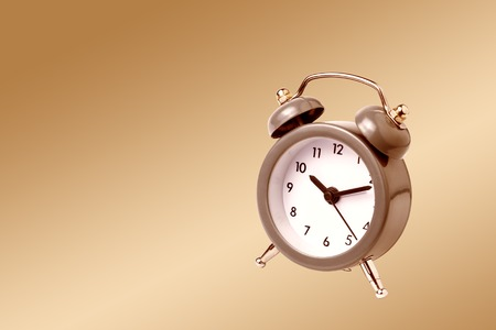 clock work: Metal Alarm clock work time 10 am on gold background