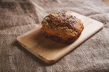homemade bread: Freshly baked homemade bread on rustic dark wooden background